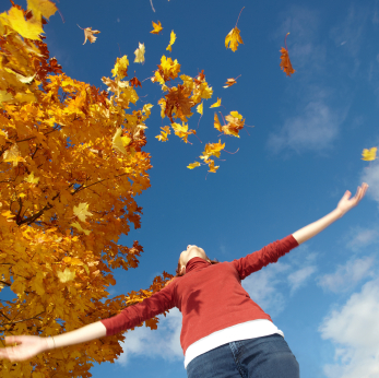 Throwing fall leaves